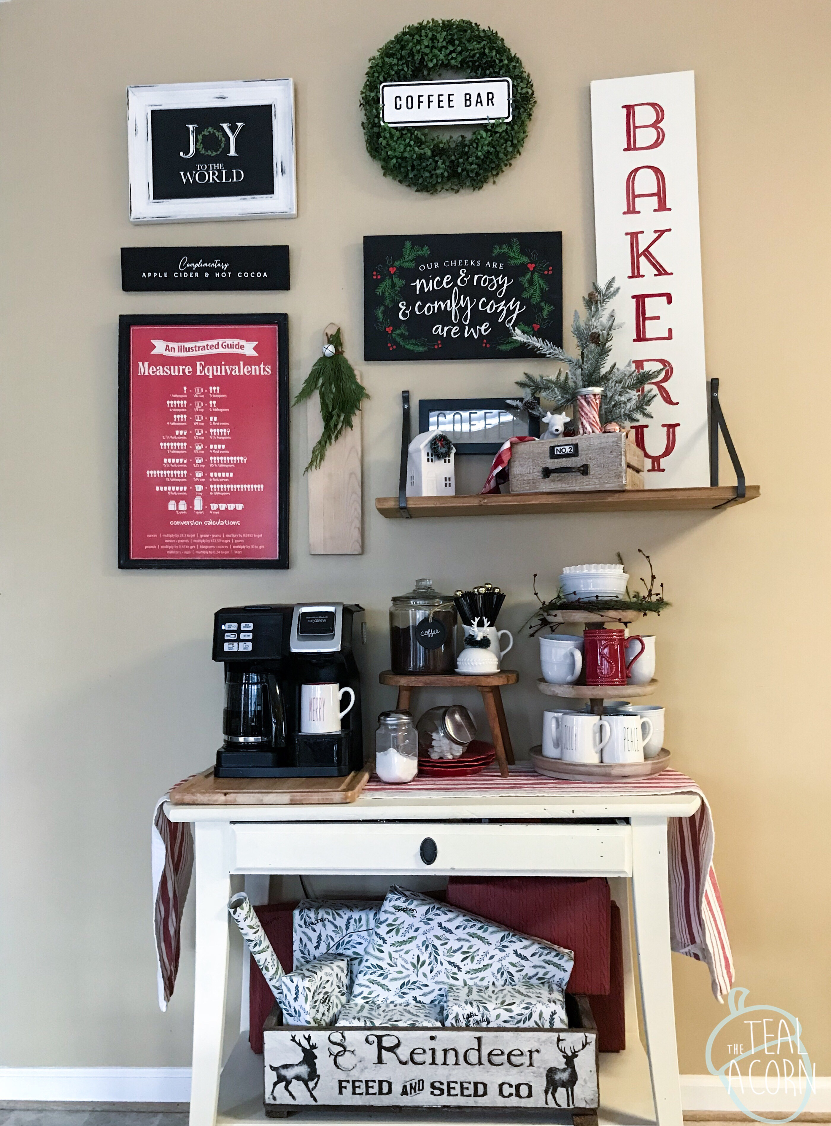Christmas Gallery wall with Chalk Couture Joy to the world, bakery, vintage truck complimentary cocoa and cider, our cheeks are nice and rosy and comfy cozy are we transfers.  Gallery wall is set above a coffee station. Walls are Sherwin Williams Safari.