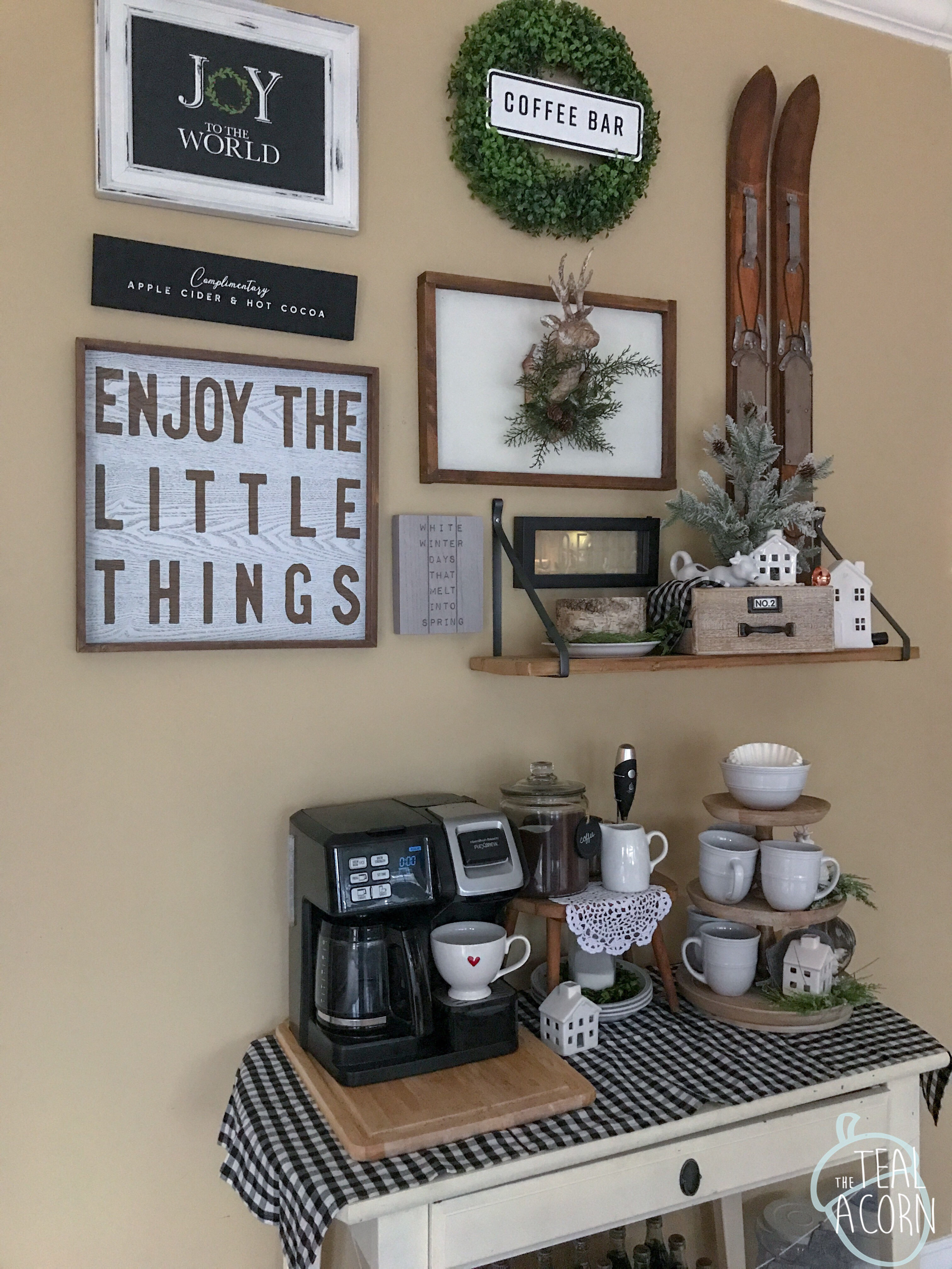 Winter gallery wall that changes seasonally. It is located above a coffee bar. Farmhouse style signs