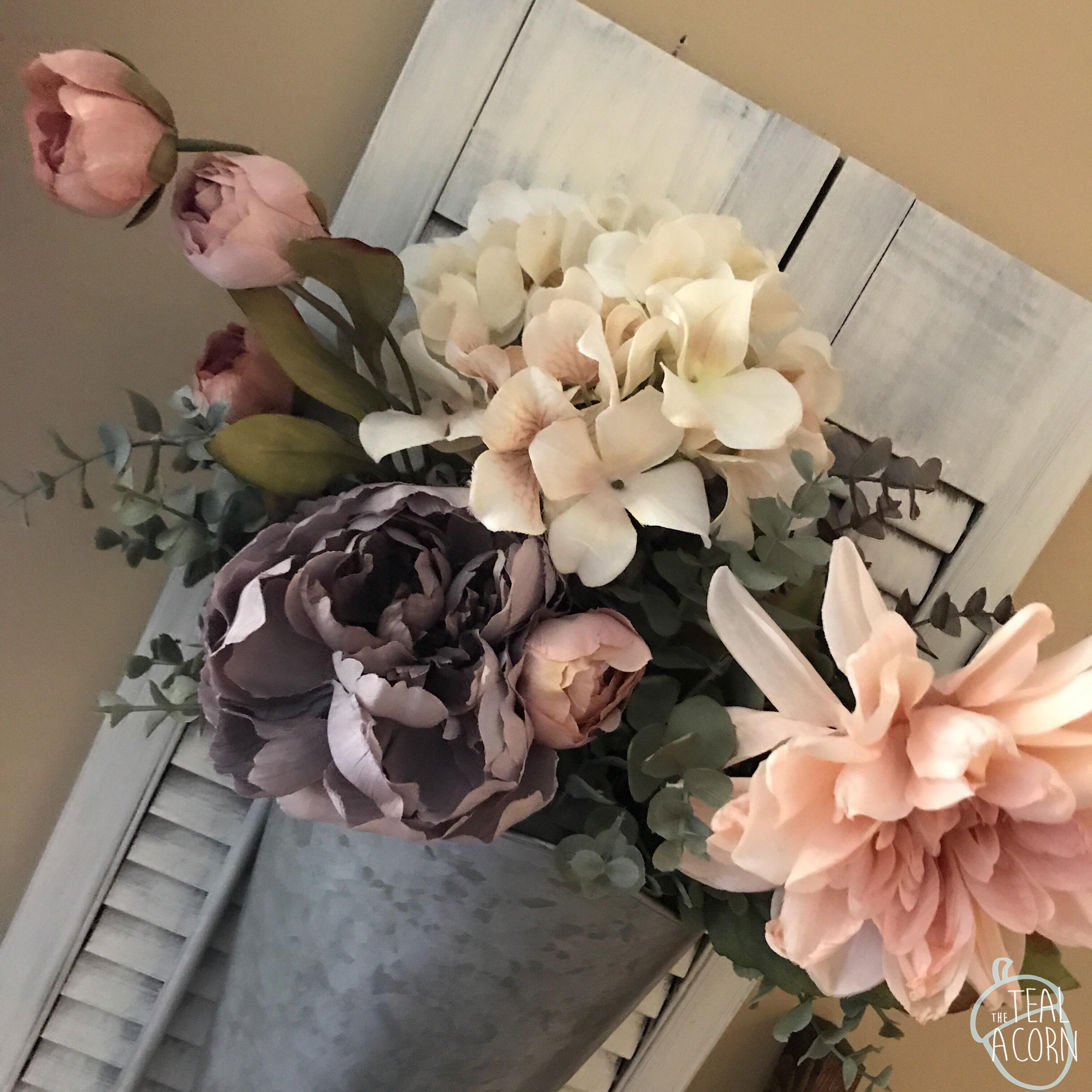 spring flowers in a shutter vase