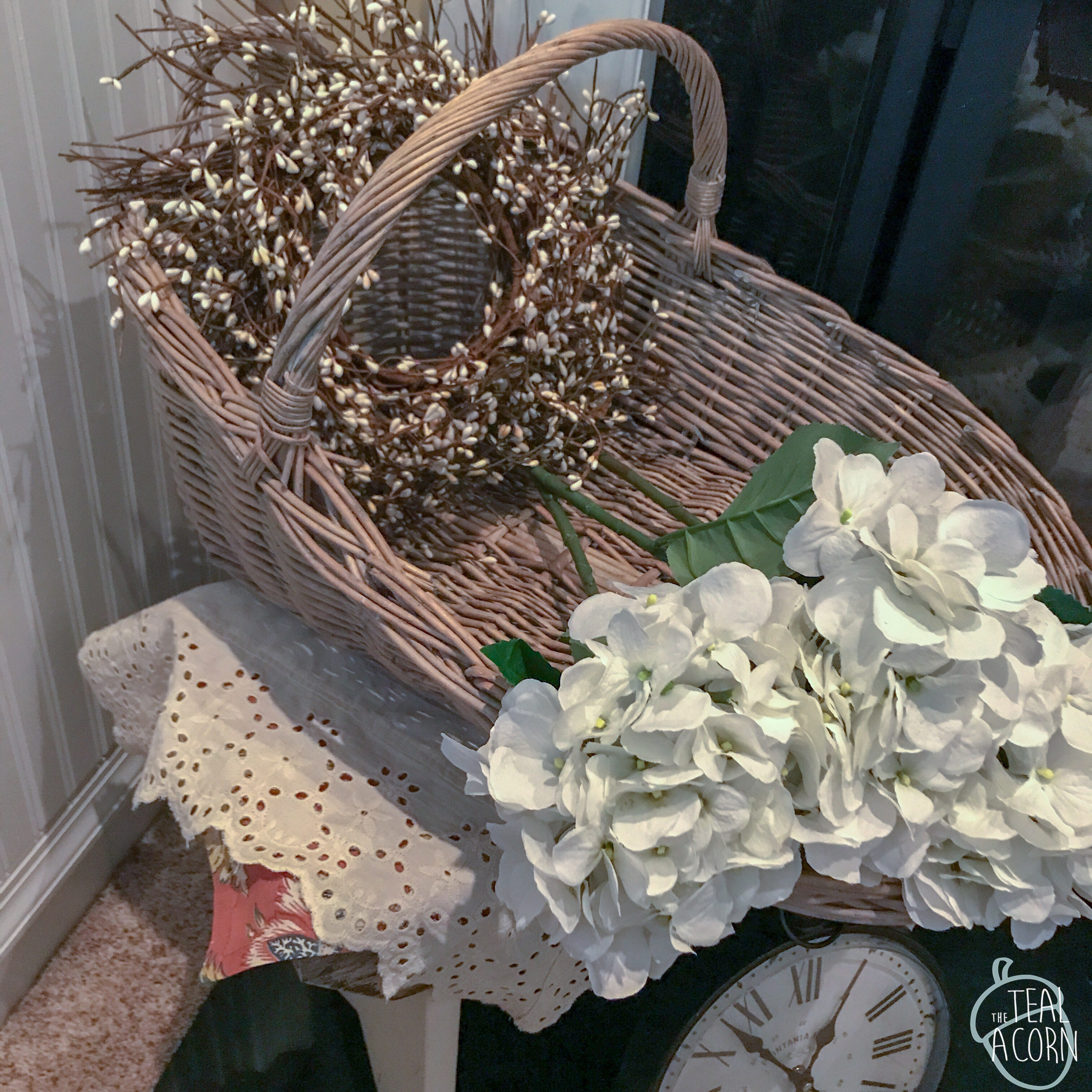 wicker gathering basket with white hydrangeas
