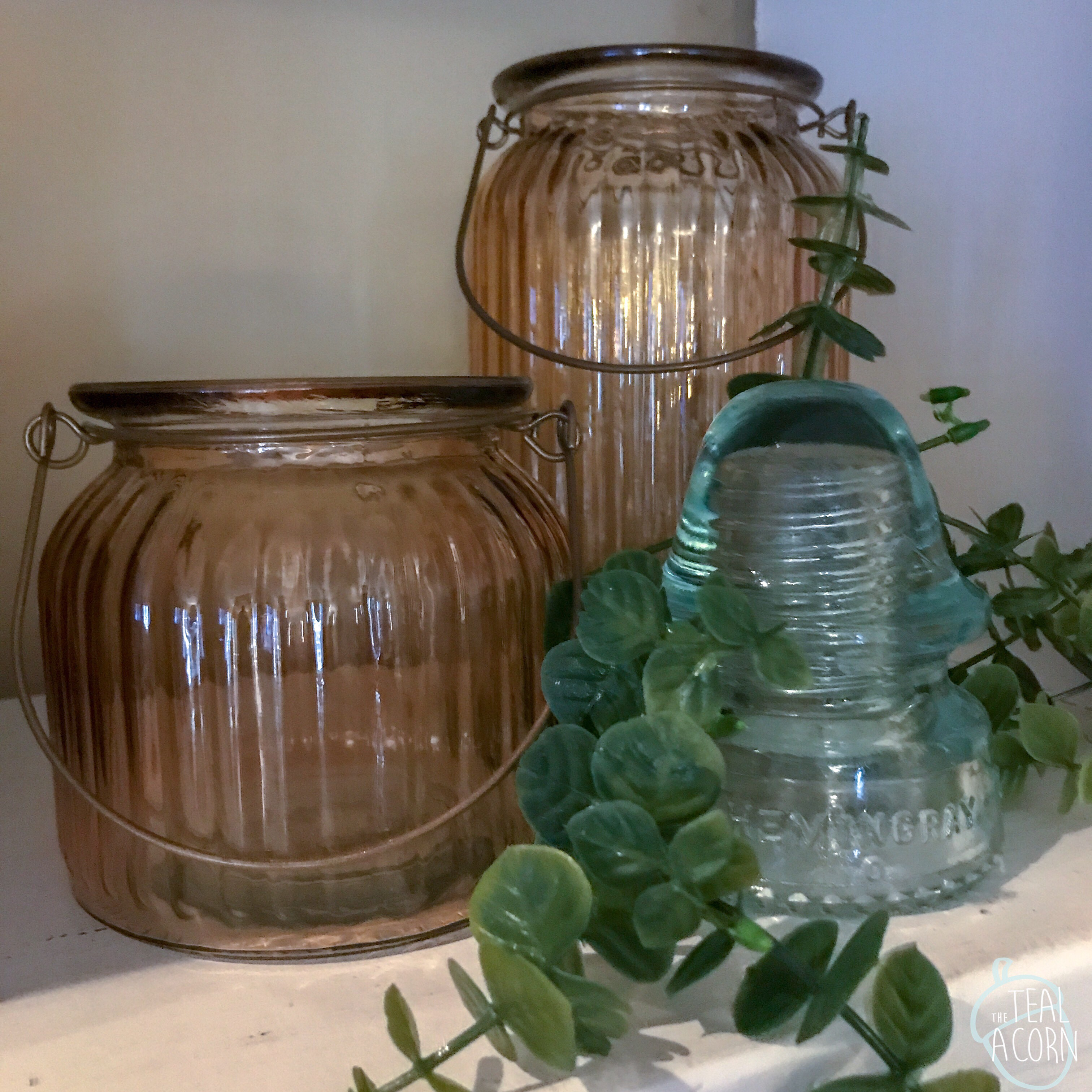 orange glass jars and old electrical insulator vignette decor